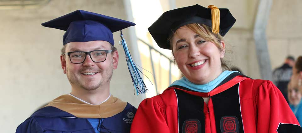 Three happy graduates at commencement